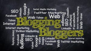 Blogging bloggers on black chalkboard with marketing terminology.