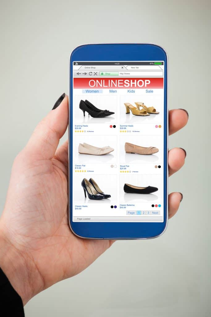Woman seeing shoes online that are shown from marketing campaigns.